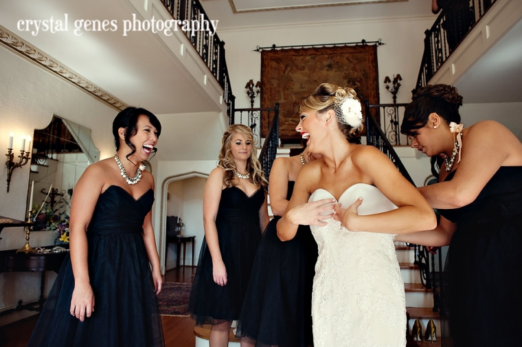 A bride gets dressed with her bridesmaids at the first presbyterian church in concord nc before her wedding
